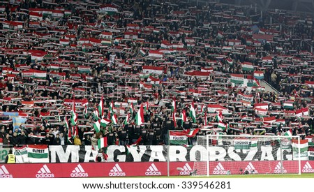 BUDAPEST, HUNGARY - NOVEMBER 15, 2015: Hungarian fans listen to the national anthem during Hungary vs. Norway UEFA Euro 2016 qualifier play-off football match at Groupama Arena. - stock photo