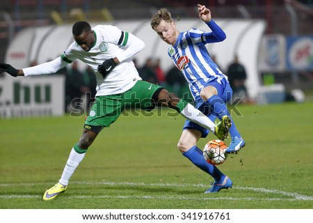 BUDAPEST, HUNGARY - NOVEMBER 21, 2015: Marek Strestik of MTK (r) is attacked by Roland Lamah of Ferencvaros during MTK Budapest - Ferencvaros OTP Bank League football match at Illovszky Stadium.  - stock photo