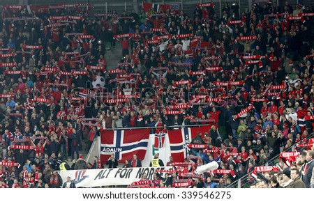 BUDAPEST, HUNGARY - NOVEMBER 15, 2015: Norwegian supporters during Hungary vs. Norway UEFA Euro 2016 qualifier play-off football match at Groupama Arena. - stock photo