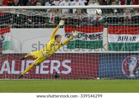 BUDAPEST, HUNGARY - NOVEMBER 15, 2015:The first Hungarian goal is watched by Norwegian goalkeeper Orjan Nyland during Hungary vs. Norway UEFA Euro 2016 qualifier play-off match at Groupama Arena.