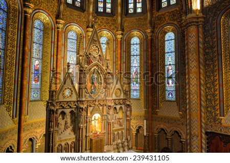 BUDAPEST, HUNGARY - NOVEMBER 28, 2014: The interior of Matthias Church in Budapest, Hungary. The building was constructed in the florid late Gothic style in the second half of the 14th century. - stock photo