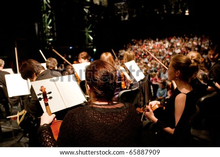 BUDAPEST, HUNGARY - NOVEMBER 20: The MAV Symphonic Orchestra performs at The Millenaris stage on Nov 20, 2010 in Budapest, Hungary. Conductor: Antal Matyas - stock photo