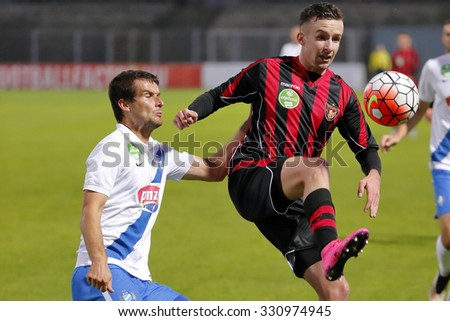 BUDAPEST, HUNGARY - OCTOBER 24, 2015: Duel between Mato Grgic of MTK (l) and Richard Vernes of Honved during MTK vs. Honved OTP Bank League football match in Illovszky Stadium. - stock photo