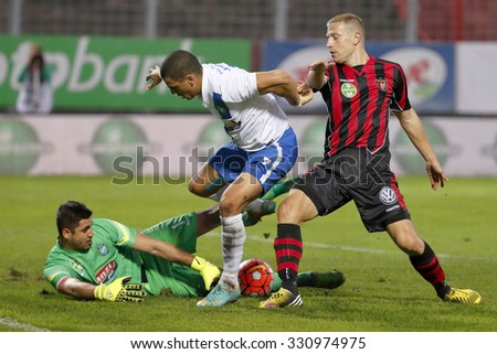 BUDAPEST, HUNGARY - OCTOBER 24, 2015: Hegedus of MTK (l) tries to get the ball next to Ramos and Kamber (r) of Honved during MTK vs. Honved OTP Bank League football match in Illovszky Stadium.  - stock photo