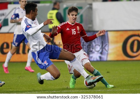 BUDAPEST, HUNGARY - OCTOBER 8, 2015: Hungarian Adam Nagy (r) is tackled by Faroese Ragnar Nattestad during Hungary vs. Faroe Islands UEFA Euro 2016 qualifier football match in Groupama Arena. - stock photo