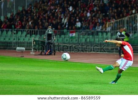 BUDAPEST, HUNGARY - OCTOBER 11 : Hungarian international Tamas Hajnal shoots a free kick at Hungary - Finland European Cup qualifier football match at October 11, 2011 in Budapest, Hungary. - stock photo