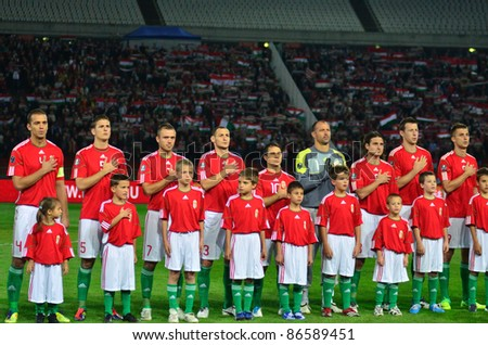 BUDAPEST, HUNGARY - OCTOBER 11 : Hungarian national football team during the national anthem at Hungary - Finland European Cup qualifier football match at October 11, 2011 in Budapest, Hungary. Unidentified kids - stock photo