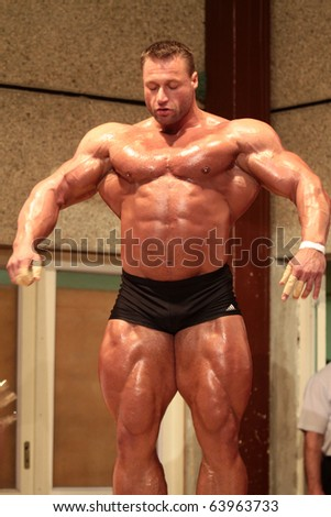 BUDAPEST, HUNGARY - OCTOBER 24: Kormany Mihaly NAC pro bodybuilder participates of the Bodysport Kupa Bodybuilding Championship as a guestposer on October 24, 2010 in Budapest, Hungary