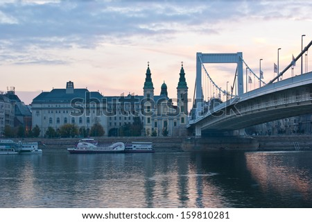 BUDAPEST, HUNGARY - OCTOBER 20, 2013: The morning city reflects in waters of Danube river, Budapest, Hungary.
