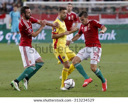 BUDAPEST, HUNGARY - SEPTEMBER 4, 2015: Between Hungarian Fiola (l) and Stieber (18) watches the ball Romanian Sanmartean during Hungary vs Romania Euro 2016 qualifier football match in Groupama Arena.