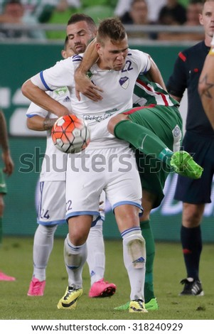 BUDAPEST, HUNGARY - SEPTEMBER 19, 2015: Duel between Attila Busai of Ferencvaros (l) and Adam Viczian of B'csaba during Ferencvaros vs. Bekescsaba OTP Bank League football match in Groupama Arena.  - stock photo