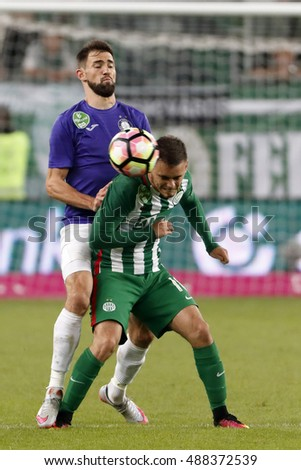 BUDAPEST, HUNGARY - SEPTEMBER 24, 2016: Gabor Nagy (L) of Ujpest FC fouls Andras Rado (R) of Ferencvarosi TC during Ferencvaros v Ujpest FC OTP Bank Liga match at Groupama Arena