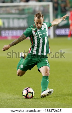 BUDAPEST, HUNGARY - SEPTEMBER 24, 2016: Gergo Lovrencsics (L) of Ferencvarosi TC controls the ball during Ferencvaros v Ujpest FC OTP Bank Liga match at Groupama Arena
