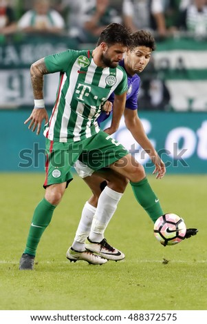 BUDAPEST, HUNGARY - SEPTEMBER 24, 2016: Marco Djuricin (L) of Ferencvarosi TC duels for the ball with Akos Kecskes (R) of Ujpest FC during Ferencvaros v Ujpest FC OTP Bank Liga match at Groupama Arena