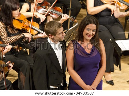 BUDAPEST, HUNGARY - SEPTEMBER 18: Mark Zimmermann and Atala Schöck, singers of the Hungarian State Opera on the stage of ELTE University on September 18, 2011 in Budapest, Hungary.