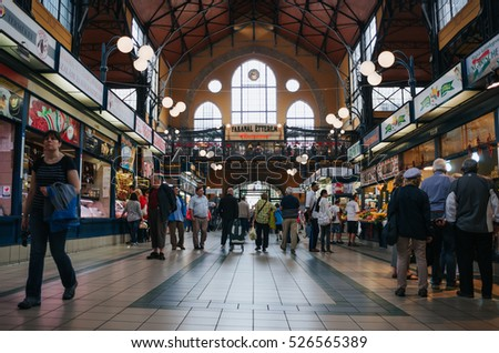 BUDAPEST, HUNGARY - SEPTEMBER 17, 2016: Peple visit Great market hall, largest indoor market in Budapest, built in 1896.