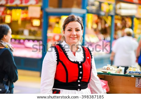 BUDAPEST, HUNGARY - SEPTEMBER 7, 2015: Portrait of a young beautiful Hungarian woman dressed with typical clothes at Budapest Central Market Hall