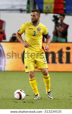 BUDAPEST, HUNGARY - SEPTEMBER 4, 2015: Romanian Razvan Rat with the ball during Hungary vs. Romania UEFA Euro 2016 qualifier football match in Groupama Arena.
