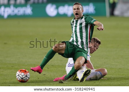 BUDAPEST, HUNGARY - SEPTEMBER 19, 2015: Stanislav Sestak of Ferencvaros (l) is tripped up by Adam Viczian of B'csaba during Ferencvaros vs. Bekescsaba OTP Bank League football match in Groupama Arena  - stock photo