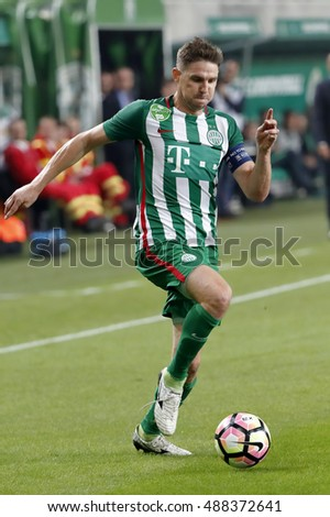 BUDAPEST, HUNGARY - SEPTEMBER 24, 2016: Zoltan Gera of Ferencvarosi TC controls the ball during Ferencvaros v Ujpest FC OTP Bank Liga match at Groupama Arena