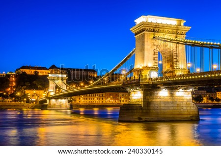 Budapest, Hungary. Twilight image of Lanchid or Chain Bridge (Szecenyi) over Danube River. - stock photo