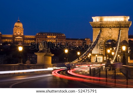 Budapest is a beautiful bridge, the cars are going.