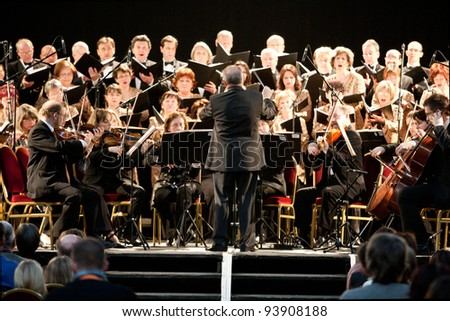 BUDAPEST - JAN 13: MAV Symphonic Orchestra perform in concert at Millenaris Budapest on January 13, 2012 in Budapest, Hungary. Conductor: Antal Matyas - stock photo