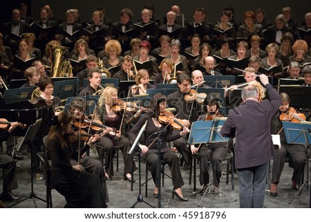 BUDAPEST - JANUARY 30: Duna Symphonic Orchestra and The National Chorus performs on stage at Thalia Theater on January 30, 2010 in Budapest, Hungary. - stock photo