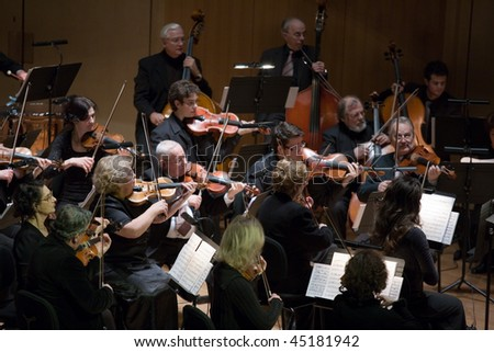 "BUDAPEST - JANUARY 23: ""Muvesz"" Symphonic Orchestra performs on stage at MUPA on January 23, 2010 in Budapest, Hungary. - stock photo"
