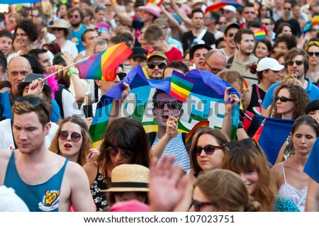 BUDAPEST, JULY 07: Unidentified people participate at the 17th Budapest Pride on 07 July 2012 in Budapest, Hungary. The Budapest Pride in one of the famous gay parades in Central Europe. - stock photo