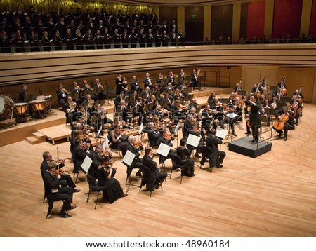 BUDAPEST - MARCH 9: Members of the  Brno Philharmonic Orchestra perform on stage at MUPA on March 9, 2010 in Budapest, Hungary.