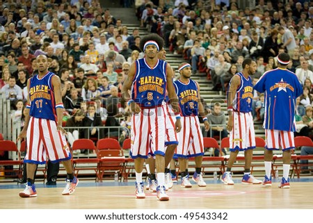 BUDAPEST - MARCH 23: The world famous Harlem Globetrotters basketball team in an exhibition match against Washington Generals at Sportarena on March 23, 2010 in Budapest, Hungary. - stock photo
