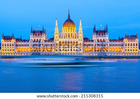 BUDAPEST - MAY 06: Hungarian Parliament on May 6, 2014. It is one of Europe's oldest legislative buildings, a notable landmark of Hungary and a popular tourist destination of Budapest. - stock photo