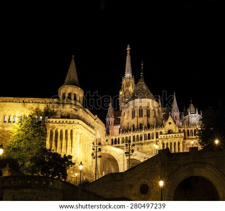 BUDAPEST MAY 9 2014: Newly renovated Mathias Church in Budapest is a big attraction for tourists all over the world. Budapest's beauty shown at night through many centuries of architecture, Hungary.  - stock photo