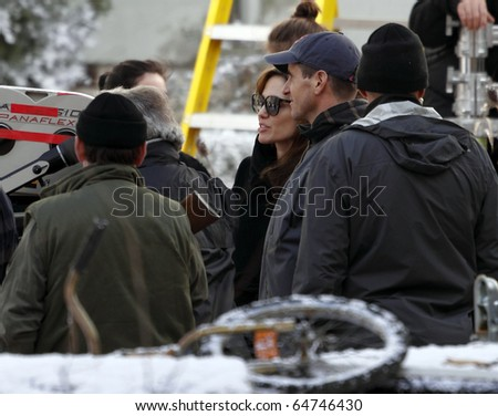 BUDAPEST - NOVEMBER 9: Angelina Jolie and some unidentified persons during Angelina Jolie's movie shooting in 9th District, on 9th November, 2010, in  Budapest, Hungary.