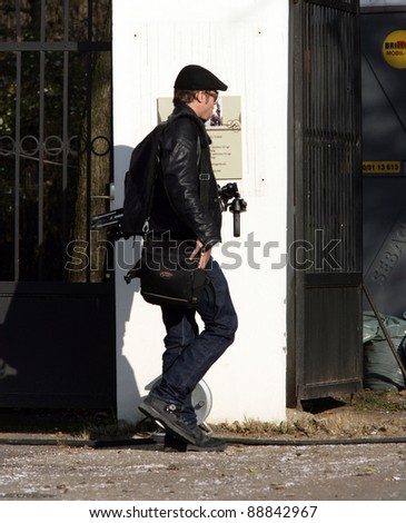 BUDAPEST - NOVEMBER 6: Brad Pitt takes his camera and tripod to the movie set where wife Angelina Jolie is filming In The Land Of Blood And Honey in Tura, Hungary, on Saturday, November 6, 2010.