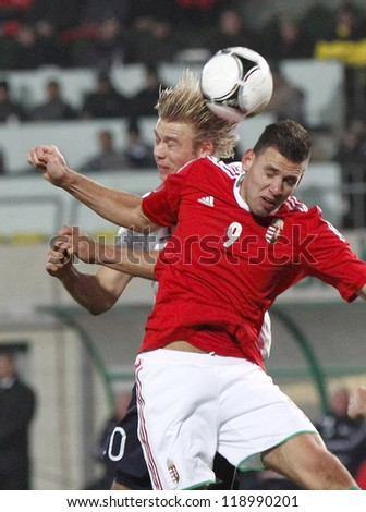 BUDAPEST - NOVEMBER 14: Hungarian Adam Szalai (9) and Norse Alexander Toft Soderlund during Hungary vs. Norway friendly football game at Pusk���¡s Stadium on November 14, 2012 in Budapest, Hungary. - stock photo