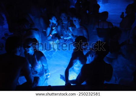 BUDAPEST - NOVEMBER 2, 2013: Tourists enjoy the Magic Bath Party at the Lukacs Bath, a traditional night party in a historic outdoor thermal bath heated naturally by hot springs, in Budapest, Hungary. - stock photo
