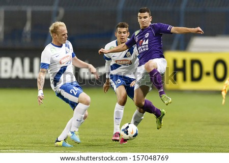 BUDAPEST - OCTOBER 5: Beside  Patrik Poor (L) and Barnabas Bese (M) of MTK is Gyula Forro of KTE during MTK vs. KTE OTP Bank League match at Hidegkuti Stadium on October 5, 2013 in Budapest, Hungary.