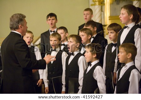 BUDAPEST-OCTOBER 6: Members of the Boy Choir of Munkacs perform at an Greek Catholic Church (conductor: Volodimir Volontir) October 6, 2009 in Budapest, Hungary - stock photo
