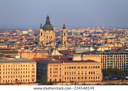Budapest roof tops and St Stephen church dome profiled on the sky, Hungary - stock photo
