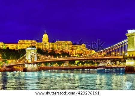 Budapest Royal Castle and Szechenyi Chain Bridge at dusk time from Danube river, Hungary. - stock photo