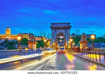 Budapest Royal Castle and Szechenyi Chain Bridge at dusk time. Hungary. - stock photo