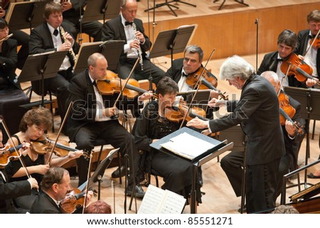 "BUDAPEST - SEPT 18: Magyar Radio Symphonic Orchestra perform on concert at ""Palace of Art"" Budapest Sept 18, 2011 in Budapest, Hungary. Conductor: Gergely Vajda"
