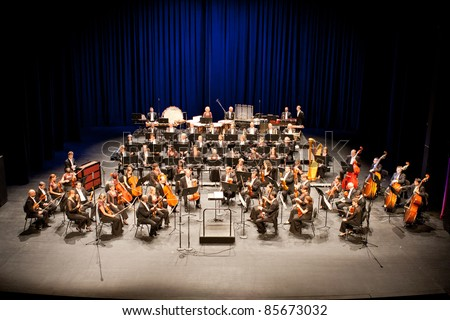 """BUDAPEST - SEPT 29: Savaria Symphonic Orchestra perform on concert  at """"Palace of Art"""" Budapest Sept 29, 2011 in Budapest, Hungary. Conductor:  Tamas Vasary - stock photo"""