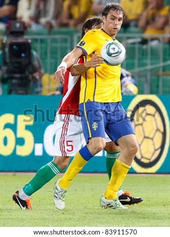 BUDAPEST - SEPTEMBER 2: Hungarian Zsolt Laczko (L) and Swedish Johan Elmander during Hungary vs. Sweden (2:1) UEFA Euro 2012 qualifying game at Puskas Stadium on September 2, 2011 in Budapest, Hungary
