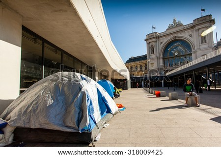 BUDAPEST - SEPTEMBER 7:  war refugees at Keleti Railway Station on 7 September 2015 in Budapest, Hungary. Refugees are arriving constantly to Hungary on the way to Germany. - stock photo