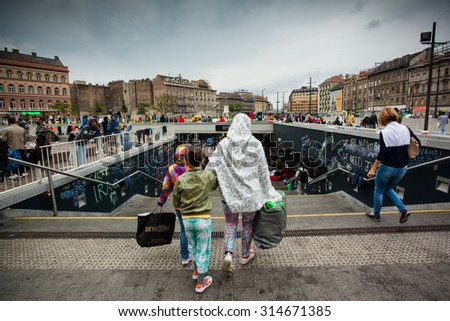 BUDAPEST - SEPTEMBER 4 : War refugees at the Keleti Railway Station on 4 September 2015 in Budapest, Hungary. Refugees are arriving constantly to Hungary on the way to Germany.