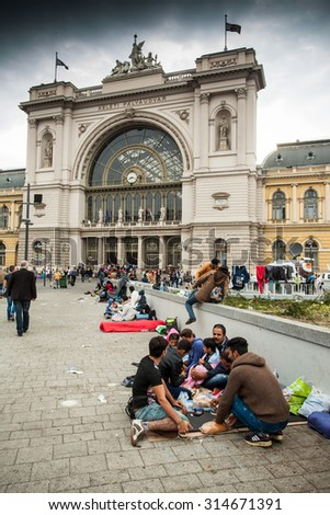 BUDAPEST - SEPTEMBER 4 : War refugees at the Keleti Railway Station on 4 September 2015 in Budapest, Hungary. Refugees are arriving constantly to Hungary on the way to Germany. - stock photo