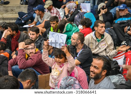 BUDAPEST - SEPTEMBER 5 : War refugees at the Keleti Railway Station on 5 September 2015 in Budapest, Hungary. Refugees are arriving constantly to Hungary on the way to Germany.
